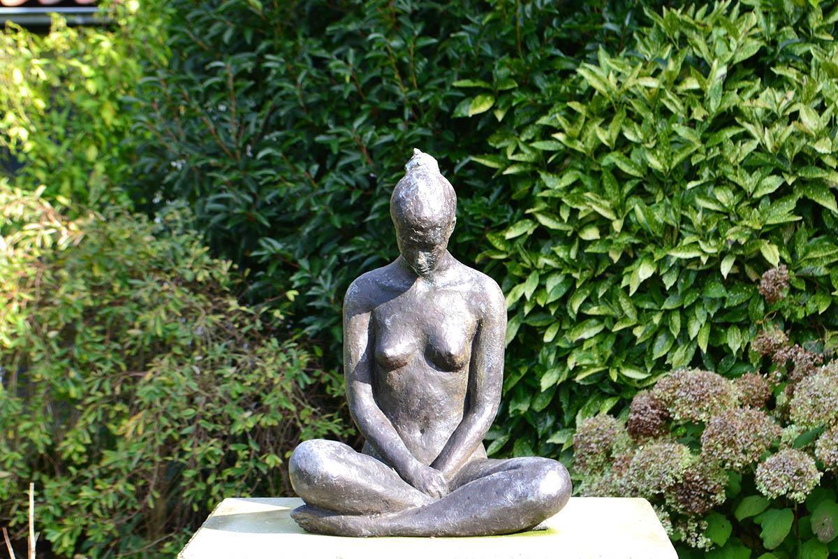 Buddha in tuin Domburg, Nederland